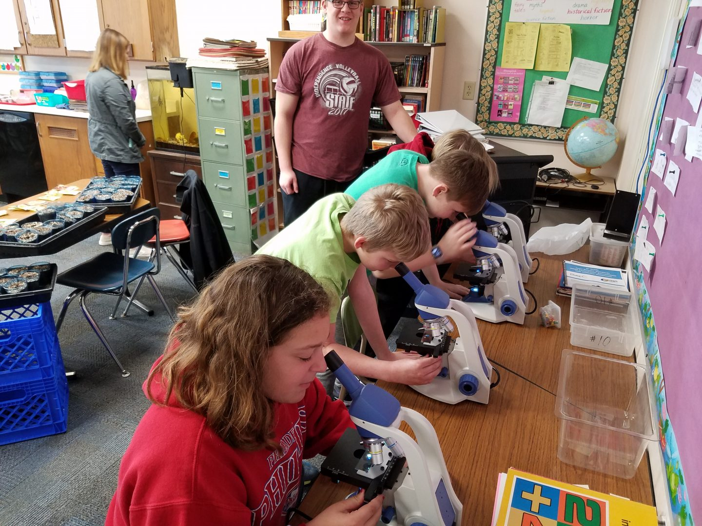 west students looking into microscopes