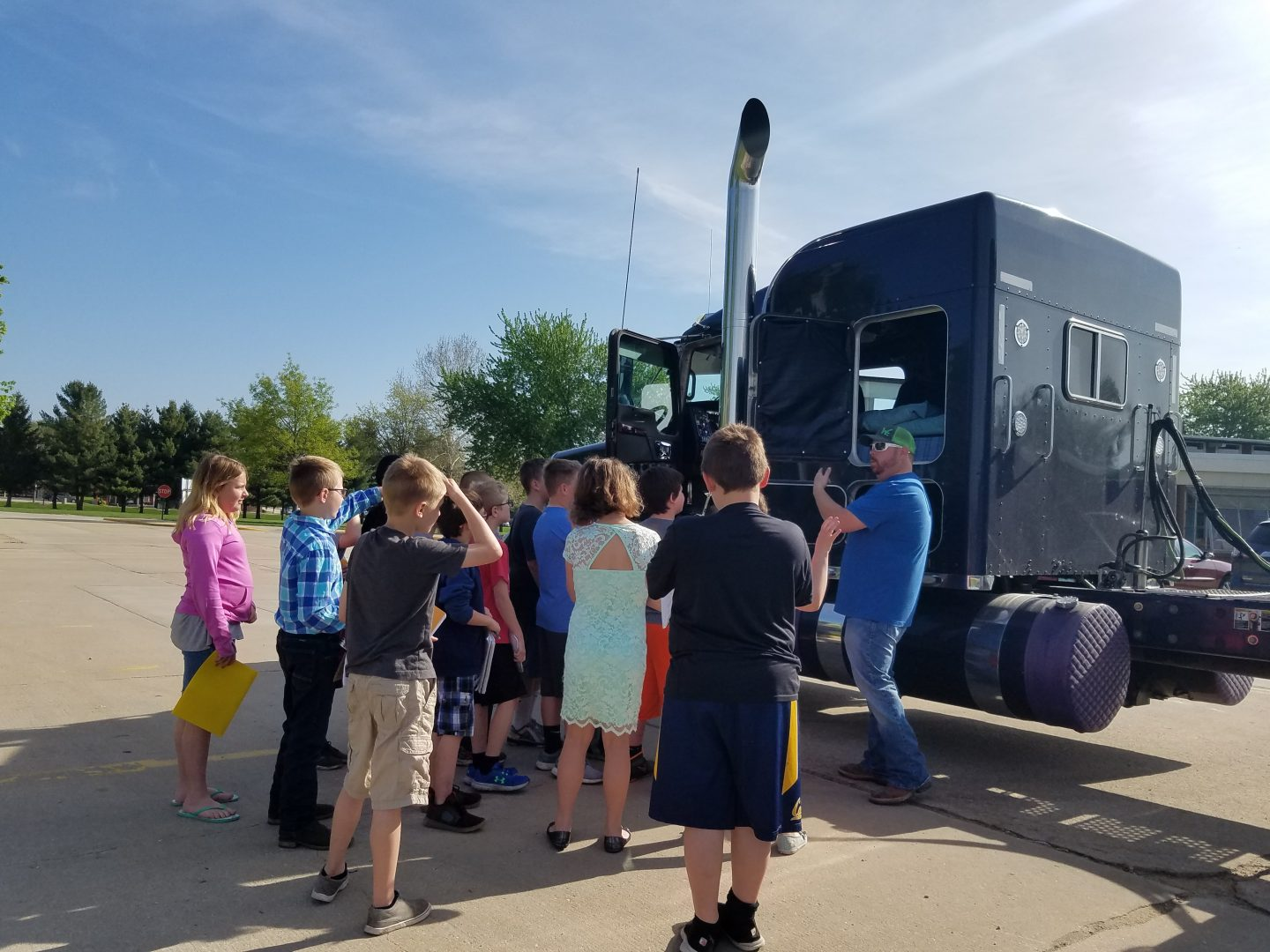 students looking at a semi on career day