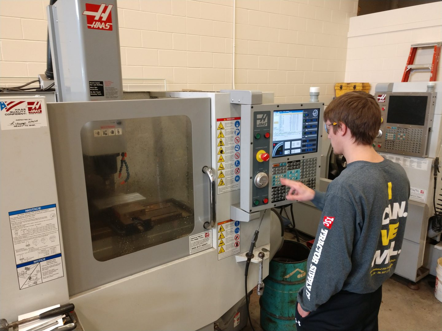 student working on machine in shop class