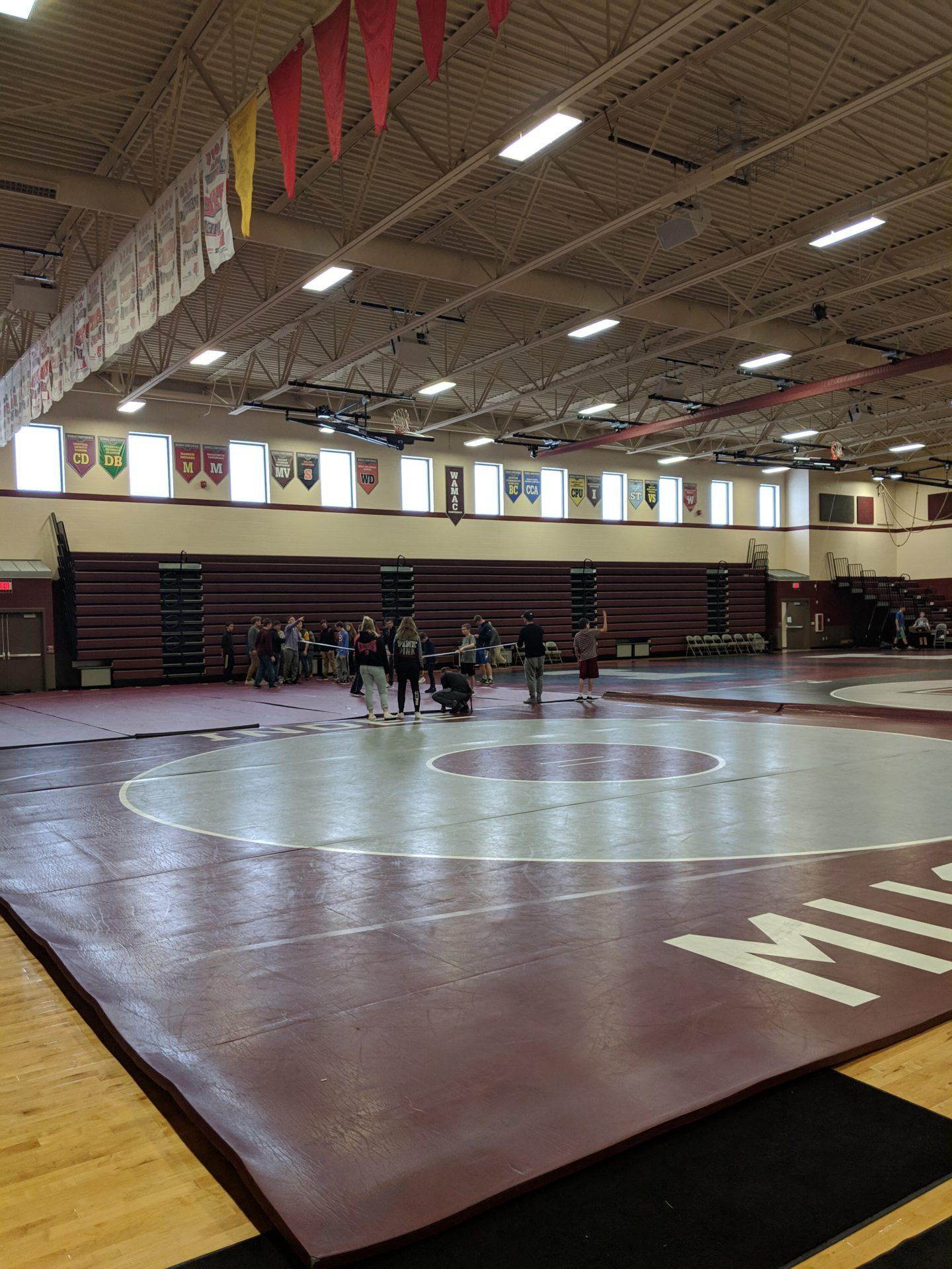 Students on wrestling mat