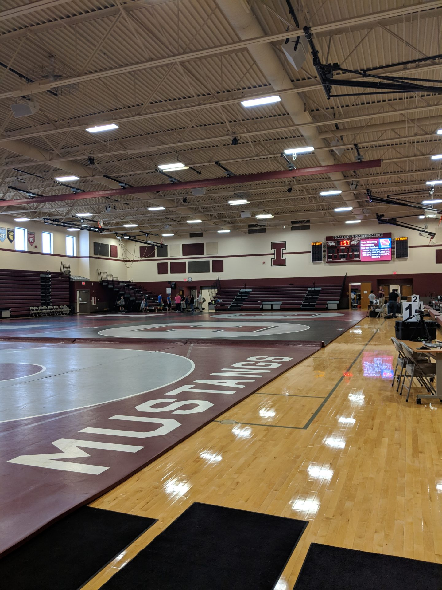 Students setting up wrestling tournement