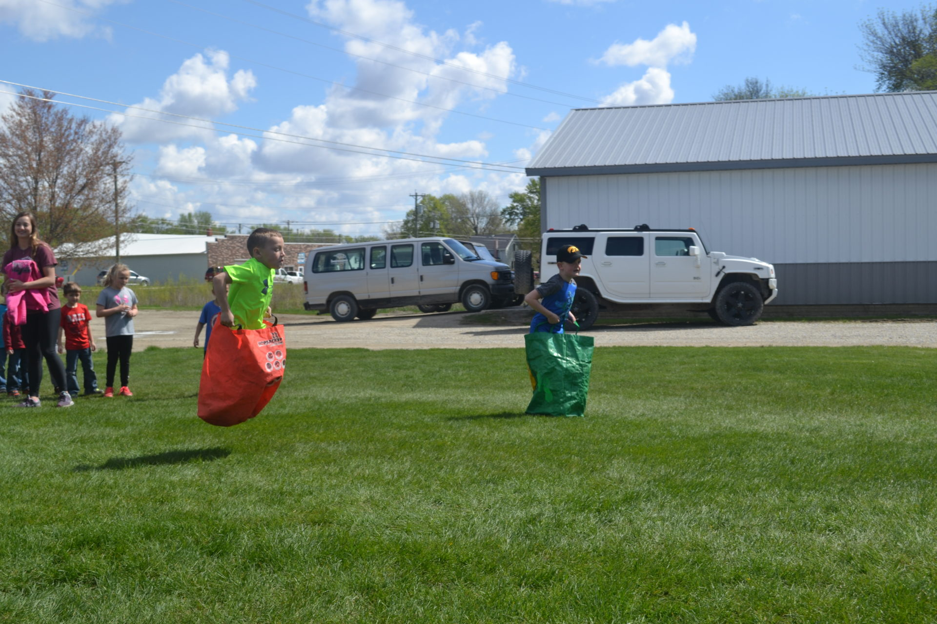 Students participate in the bean bag race during Field Day