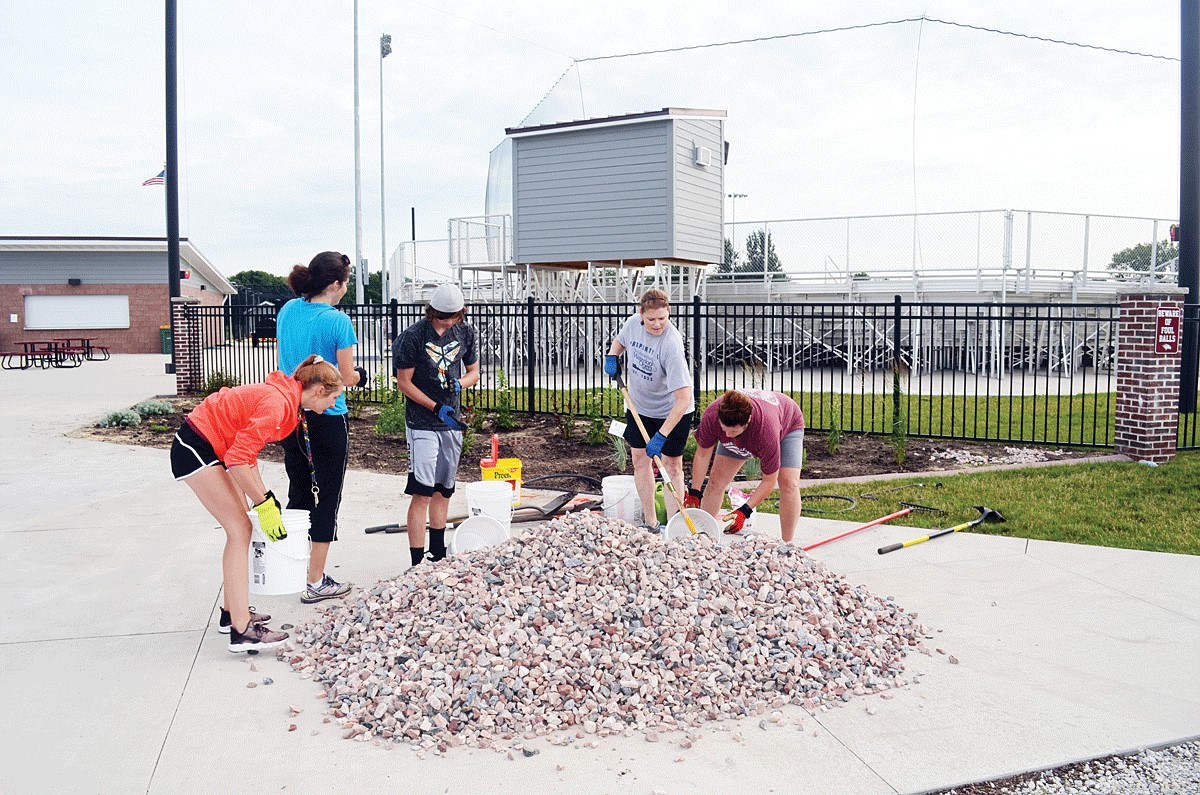 Students help with rocks