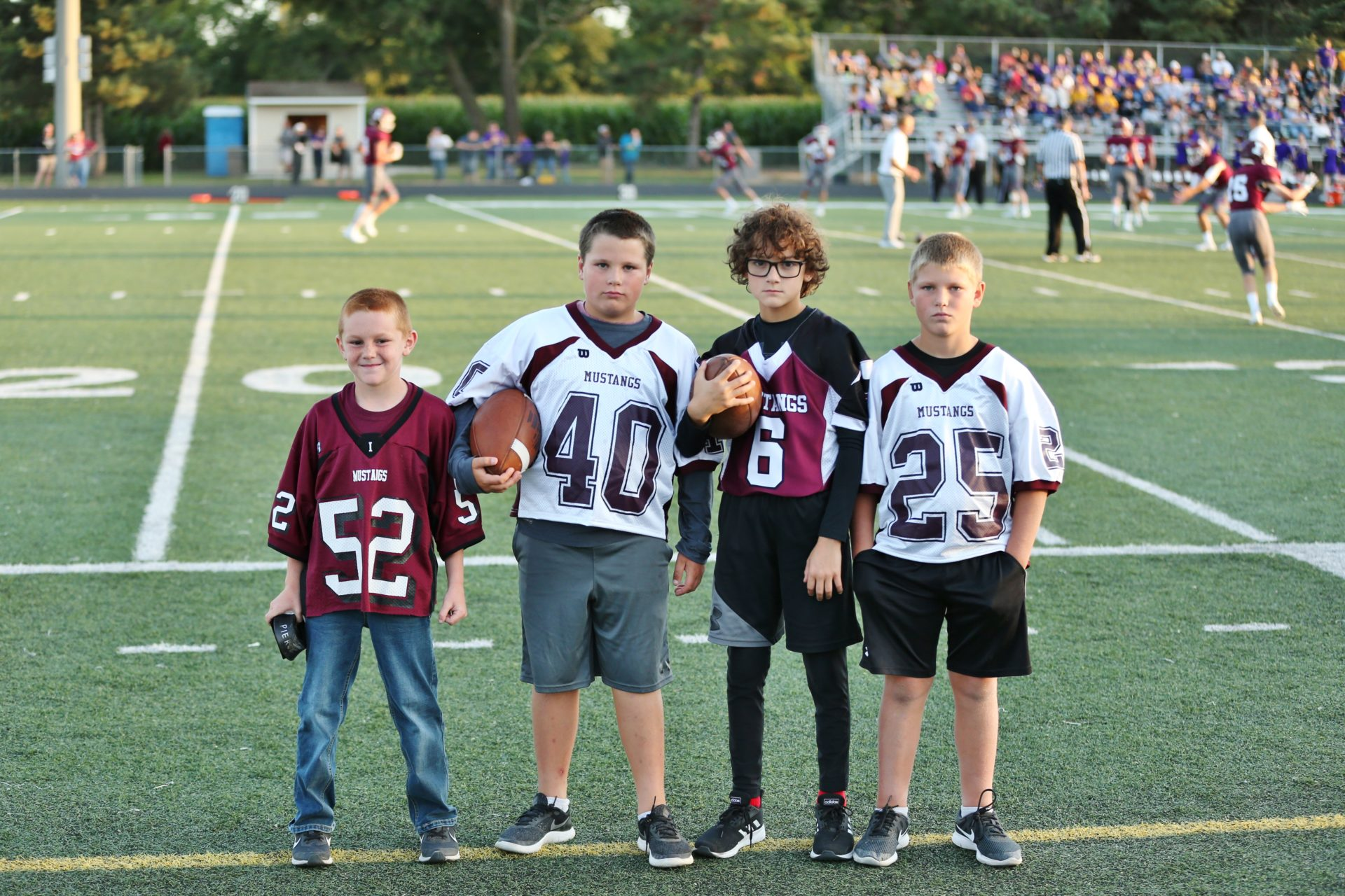 students help the football team