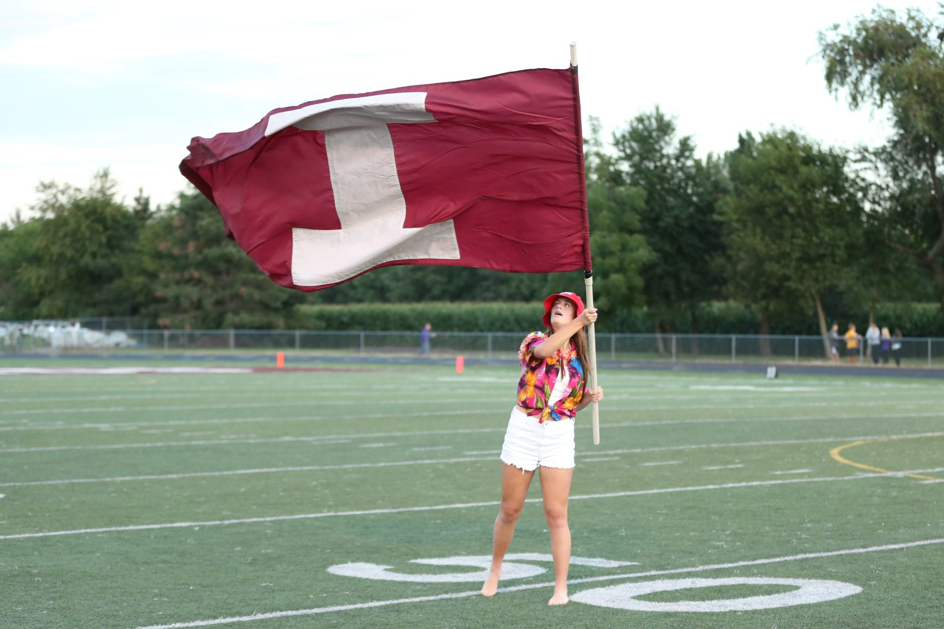 Independence student waves an Independence flag before the homecoming game