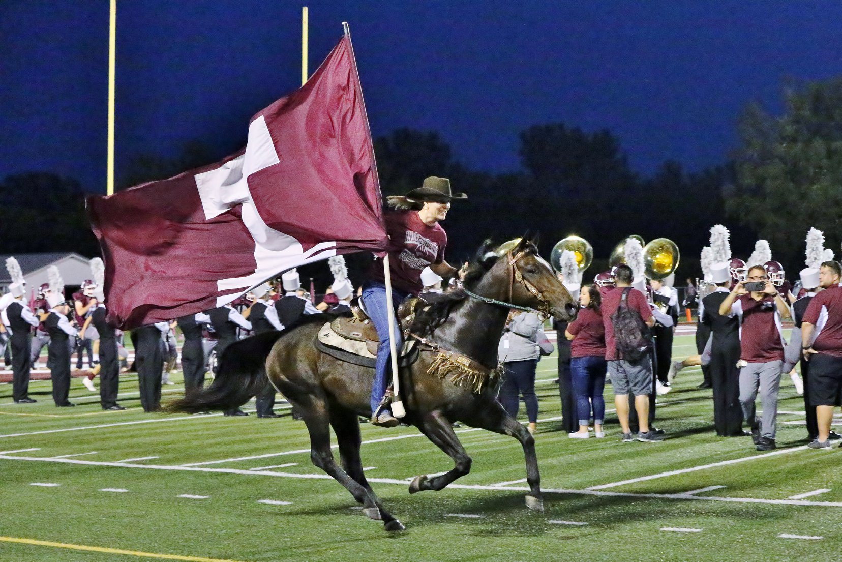 mustang enters the football field