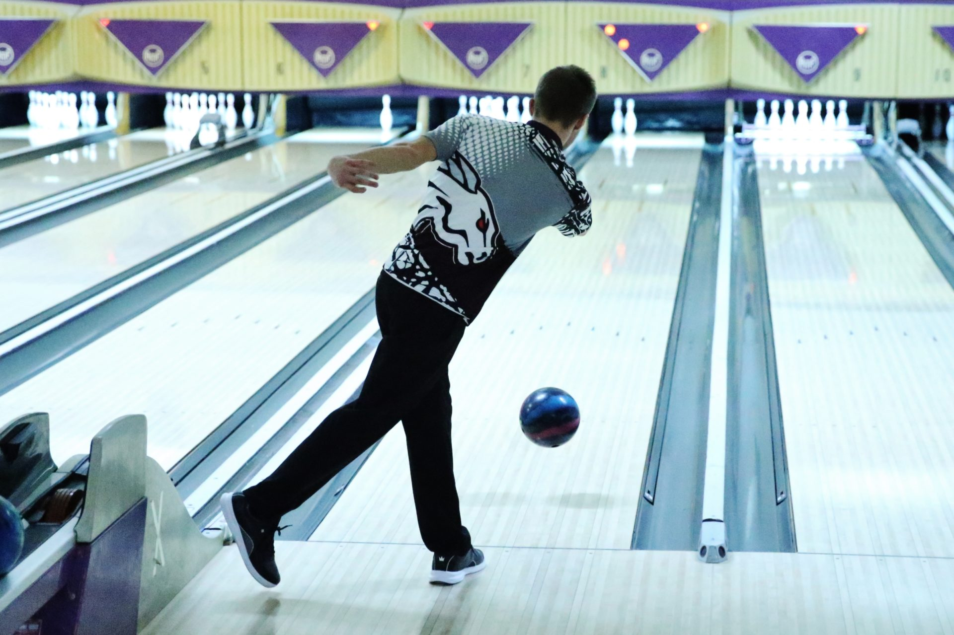 student throws bowling ball