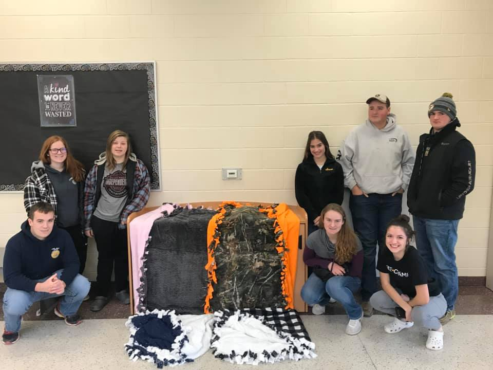 Independence ag students pose with blankets they made
