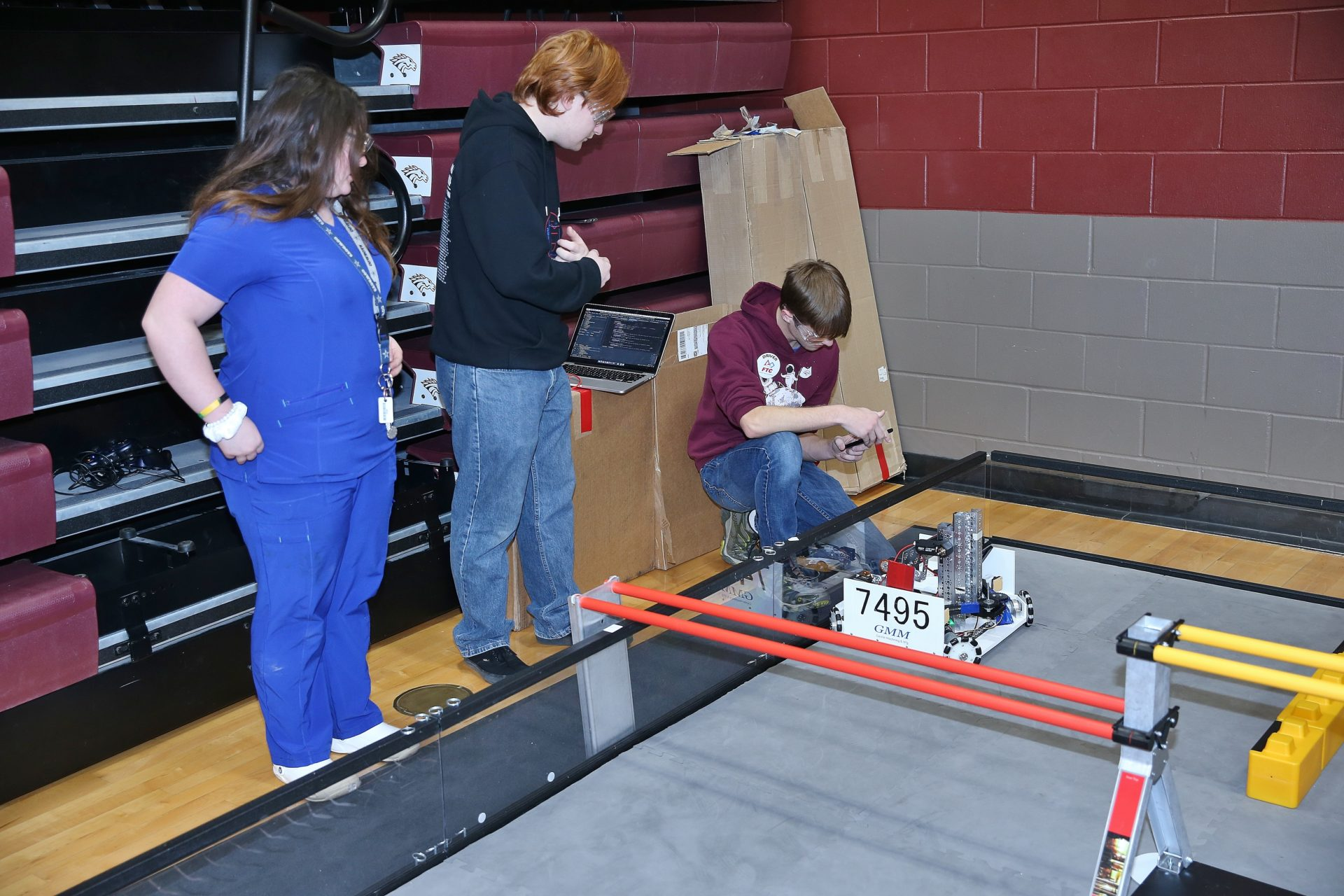 robotics students work with their robot