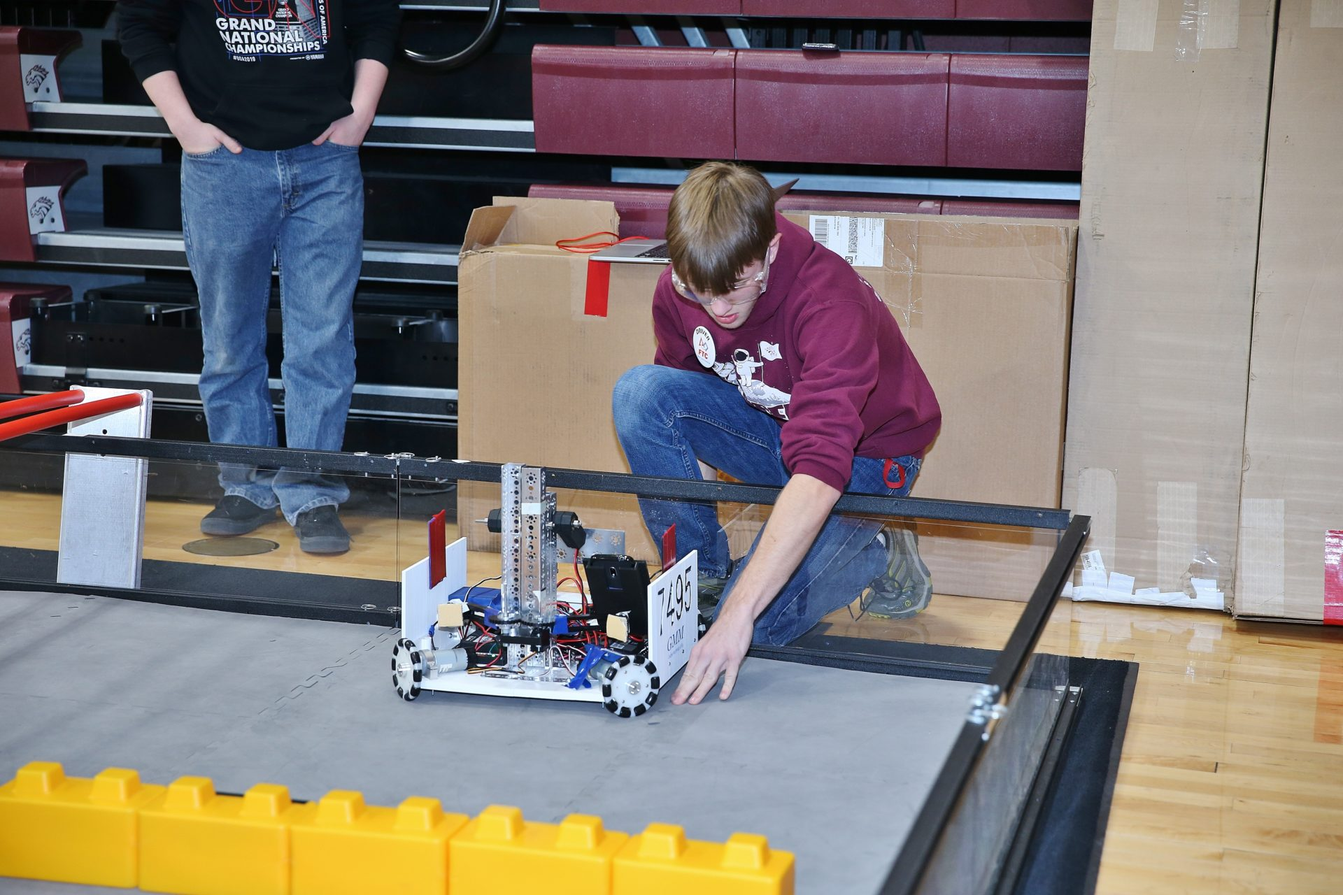 Independence student works with programmed robot