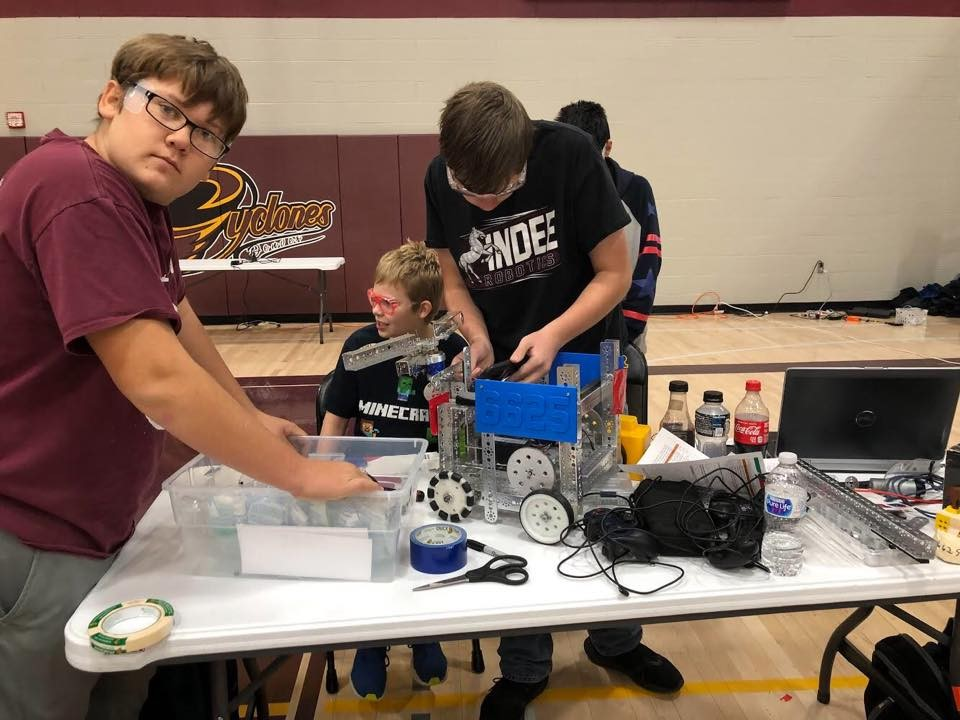 robotics students work on their robot