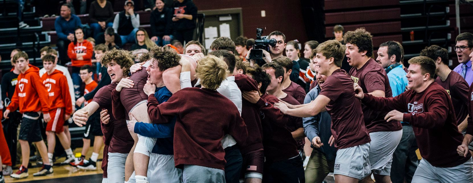 wrestling team celebrates a win